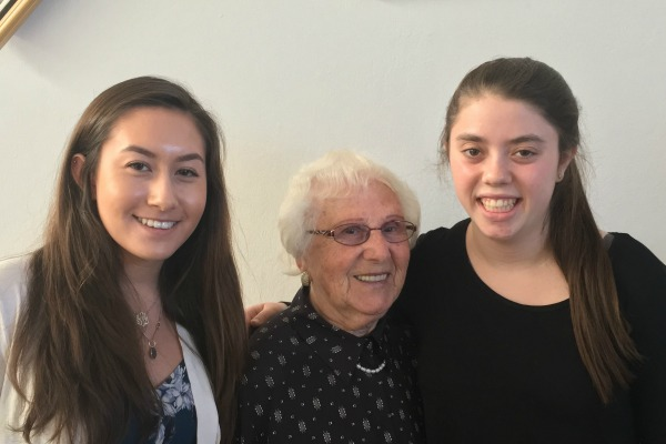 Luba, survivor of the Holocaust, with students Leah and Joy
