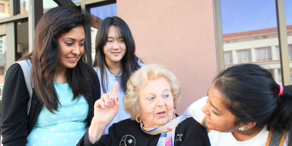 Survivor Helen F. with students at the Day of Learning