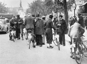 French Police check IDs during round-up of Jews, Paris.